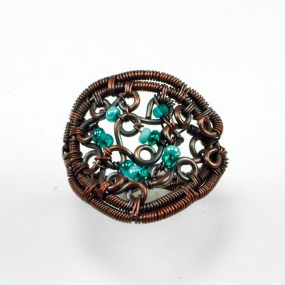 Copper ring with green glass beads