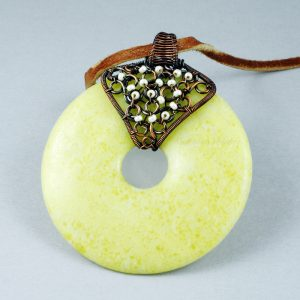 Copper and white glass beaded wire wrapped Peridot Jasper donut pendant